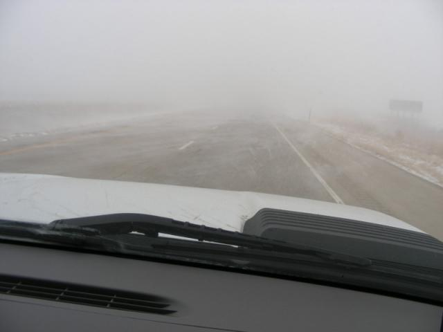 Snow blowing across road makes driving interesting